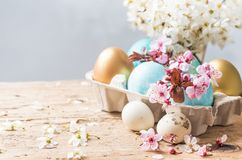 Easter colorful eggs and spring flowers background. stock photography