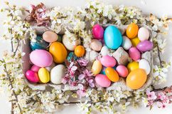 Easter colorful eggs and spring flowers background. Easter colorful eggs and spring flowers background top view royalty free stock photography