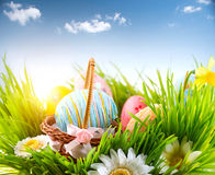 Easter. Colorful eggs in spring grass royalty free stock images