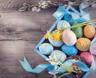 Easter. Colorful eggs and spring snowdrop flowers Stock Images