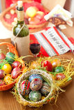 Easter colorful eggs with wine glass and bottle Stock Images