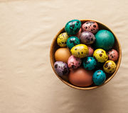 Easter. Colorful eggs in a wooden bowl. Happy Easter. Colorful eggs in a wooden bowl Stock Image