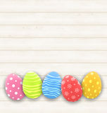 Easter colorful eggs on wooden texture Stock Photo