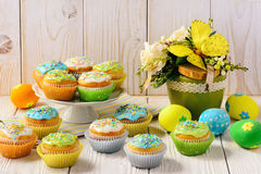 Easter colorful muffins and eggs on white table. Stock Image