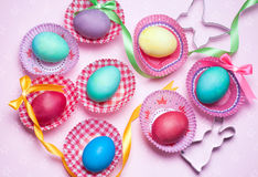 Easter colorfur eggs with ribbon and bows on pink background royalty free stock image