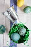 Easter coloured egg in a small decorative tin bucket stock images