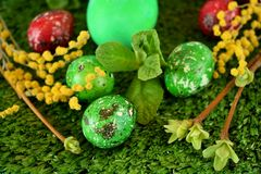 Easter coloured eggs. Surrounded by flowers on grass stock photography