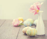 Easter. Colourful eggs and mimosa Stock Images