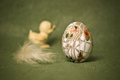 Easter composition. Colorful Easter composition with handcrafted egg, duckling and a feather Royalty Free Stock Photography