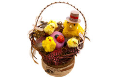 Easter composition. In wicker basket on a white background Stock Photography