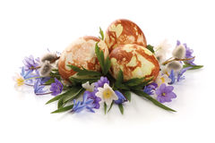 Easter composition. Hand painted easter eggs and spring flowers composition stock photo