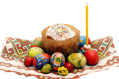 Easter composition. Easter cake, eggs and a candle on a national towel Stock Images