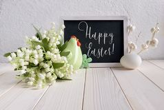 Easter composition with blackboard decorated with ceramic hen, e Stock Images