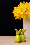 Easter composition with bunnies and narcissus Royalty Free Stock Photos