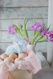 Easter composition - bunny, eggs and flowers Stock Photos