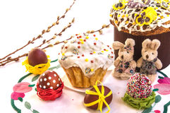 Easter composition with cakes, funny toy rabbits and eggs. royalty free stock photo
