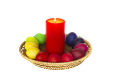 Easter composition with a candle and the painted eggs. Red preva Royalty Free Stock Photos
