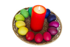 Easter composition with a candle and the painted eggs. Red preva Stock Images