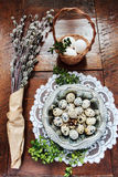 Easter composition of catkins and eggs on wooden table Royalty Free Stock Image