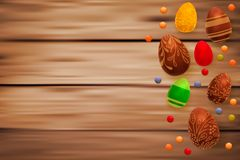 Easter composition with chocolate eggs on wooden background, space for text. 3d render realistic vector illustration. Easter composition with chocolate eggs on Stock Image