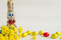 Easter composition with chocolate rabbit and eggs Royalty Free Stock Images