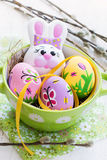 Easter composition with colored eggs and rabbit on a white background Stock Photo