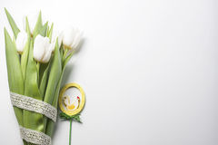 Easter composition consists of a white tulips, hand painted  woo Stock Photos