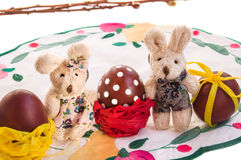 Easter composition with couple of funny toy rabbits and eggs. stock photography