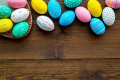 Easter composition. Decorated pastel Easter eggs on dark wooden background top view space for text stock photography