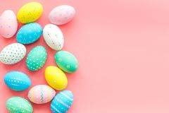 Easter composition. Decorated pastel Easter eggs on pink background top view space for text royalty free stock photo