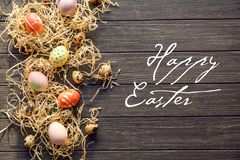 Easter composition with dyed eggs  on wooden background stock photos