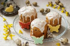 Easter composition of Easter cakes, biscuits, eggs and forsythia flowers. Rustic style royalty free stock photography