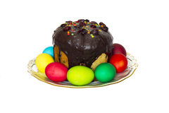 Easter composition of Easter cakes and colored eggs. Red prevail Stock Image