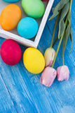 Easter composition. Easter eggs and flowers. On the table Stock Photos