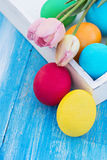 Easter composition. Easter eggs and flowers. On the table Royalty Free Stock Photography