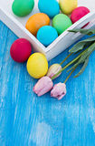 Easter composition. Easter eggs and flowers. On the table Stock Photo