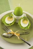 Easter composition with eggs and candle Stock Photo