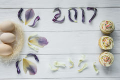 Easter composition with eggs and dried violet petals of flowers. Inscription 2017 Stock Photography