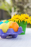 Easter composition. Easter eggs and flowers on the table Royalty Free Stock Images