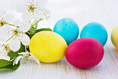 Easter composition. Easter eggs and flowers on the table Royalty Free Stock Photos