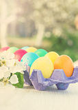 Easter composition. Easter eggs and flowers on the table. Tonned photo Stock Photo