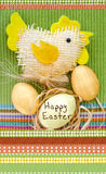 Easter composition with eggs and handmade toy chicken on a green and ornamental cloth Royalty Free Stock Photos