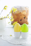 Easter composition with eggs holiday cake and flowering branches Stock Photos
