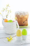 Easter composition with eggs holiday cake and flowering branches on wooden Stock Photos
