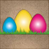 Easter composition, eggs, recycled cardboard Royalty Free Stock Images