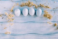 Easter composition with eggs and wildflowers Stock Images