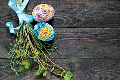 Easter composition of green branches and eggs in quilling techni Royalty Free Stock Photo