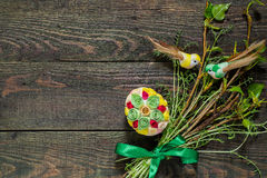 Easter composition of green branches and eggs in quilling techni Stock Photo
