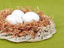 Easter composition: nest with three white eggs Stock Photography