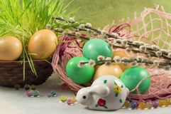 Easter composition. Painted eggs willow and rabbit Stock Photo